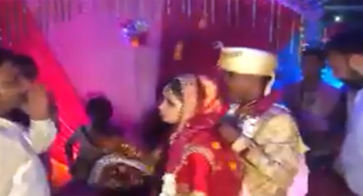bride slaps man during wedding video viral