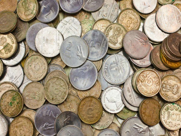 why indians dropping coins in to holy revers and praying