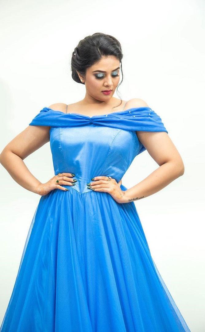 Sreemukhi Latest in a blue dress Photos